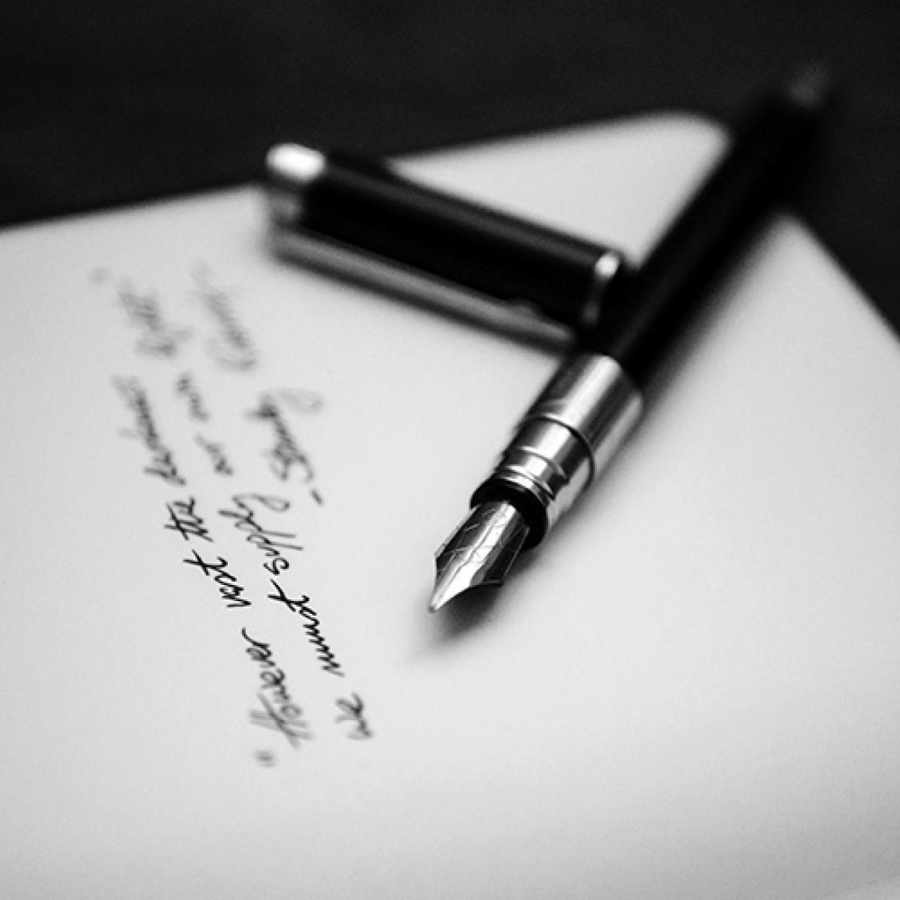 Fountain pen and paper by Alvaro Serrano. Unsplash.
