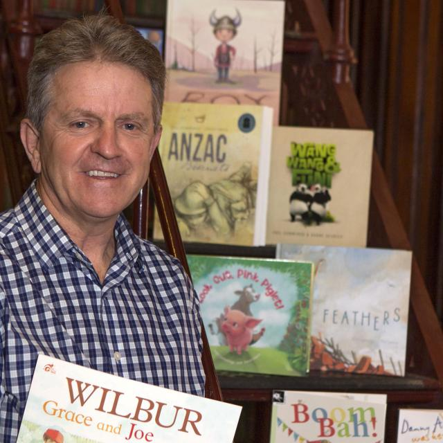 Phil Cummings with some of his books